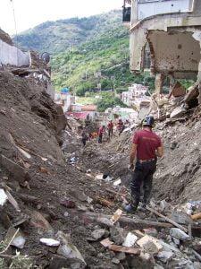 La scia di morte e distruzione lasciata dalla frana killer che il 1 Ottobre 2009 travolse l'abitato di Giampilieri