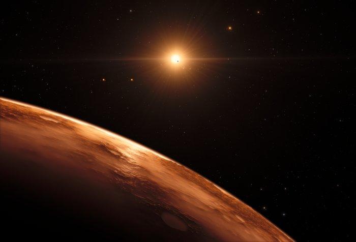 Questa rappresentazione artistica mostra la veduta dall'alto dalla superficie di uno dei pianeti del sistema di TRAPPIST-1. Sono almeno sette i pianeti in orbita intorno alla stella nana ultrafredda a circa 40 anni luce dalla Terra e hanno tutti una dimensione simile a quella della Terra. Molti sono alla giusta distanza dalla stella perché l'acqua possa essere liquida sulla superficie. Credit: ESO/M. Kornmesser/spaceengine.org